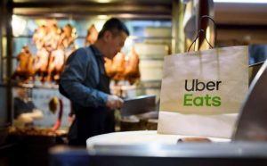 An Uber Eats delivery bag waits on the counter of a Chinese duck restaurant for it's driver to pickup.